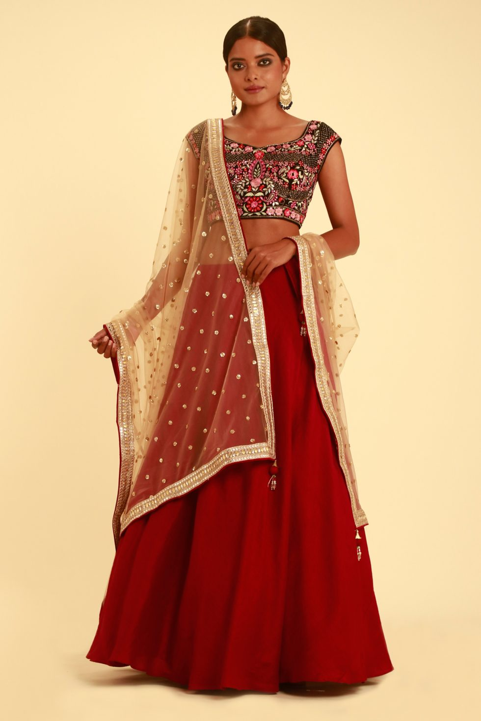 Fiery Red Lehenga And Contrast Choli with Multi Colour Floral Embroidery and Gold Dupatta