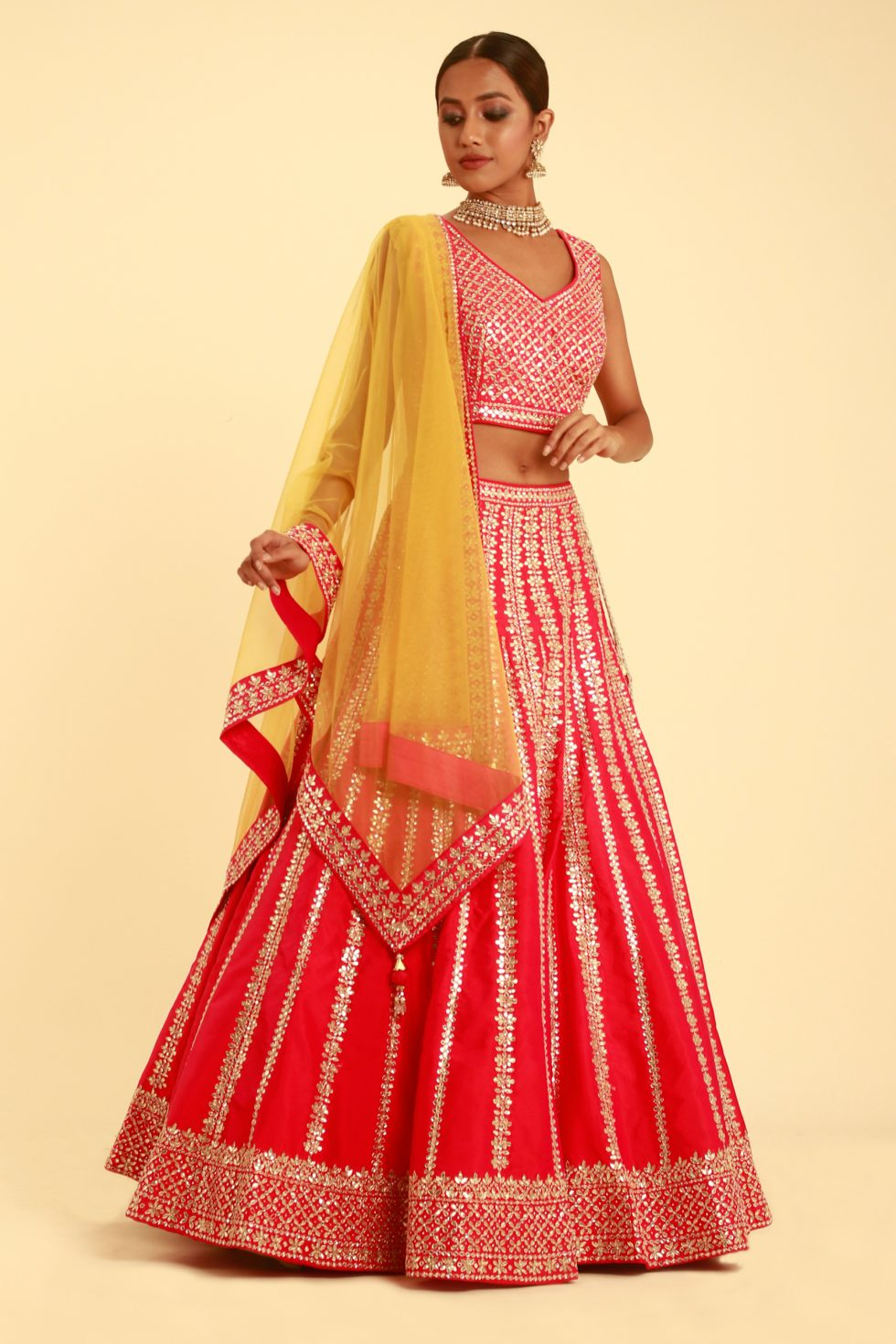 Cherry red gota work lehenga set with contrast yellow dupatta and matching embroidered border