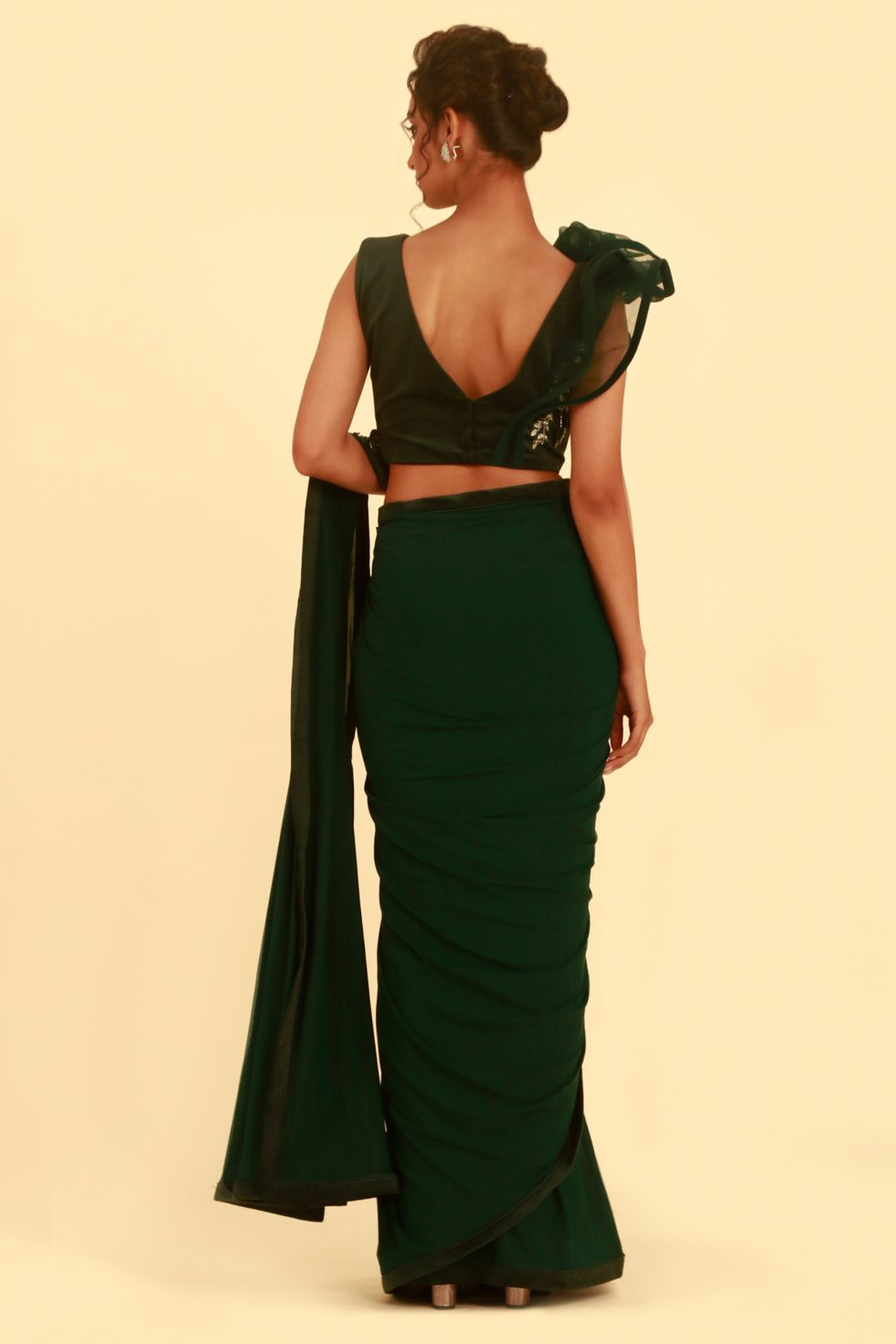 Forest green saree with matching blouse with silver embroidery and 3-D shoulder detail