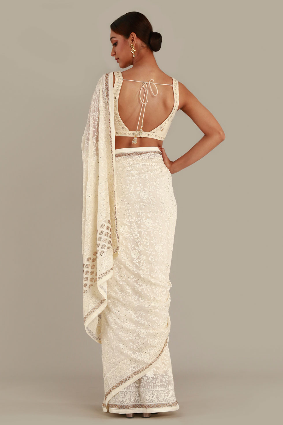 Pearly white classic saree with thread work and dull gold border and matching choli