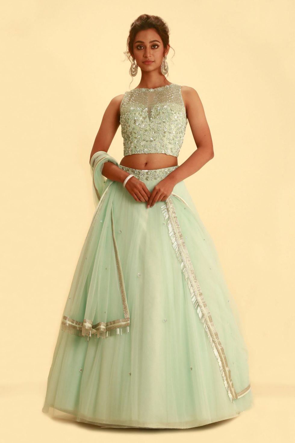 Powder blue tulle lehenga set with zardozi and aari handwork and a matching dupatta with tassels