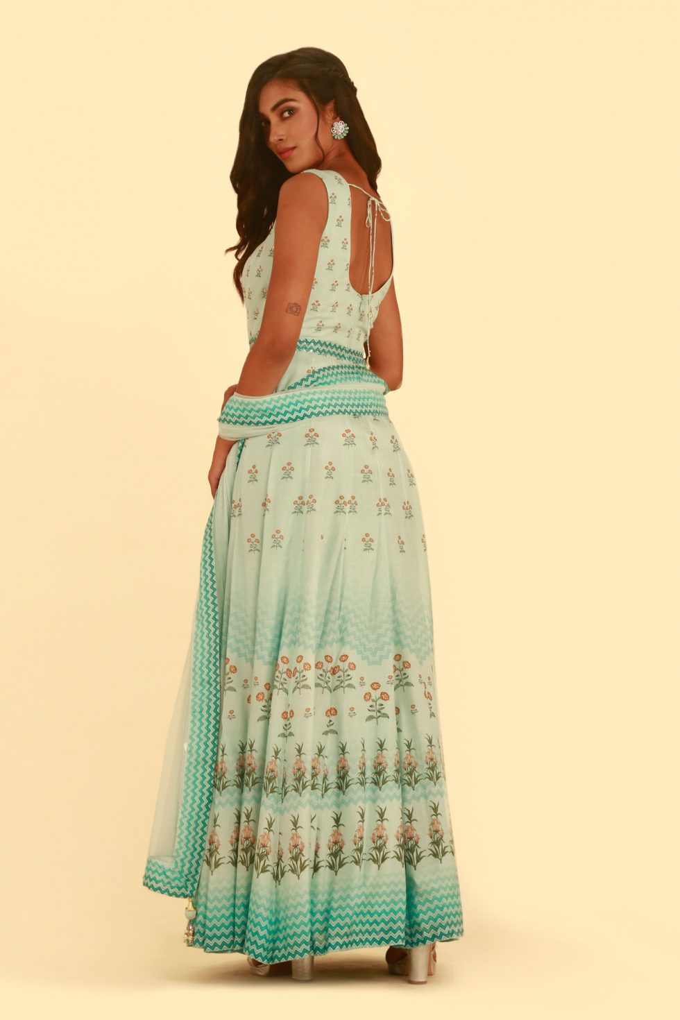 Mint green printed Anarkali gown set with matching dupatta and gold embellishments