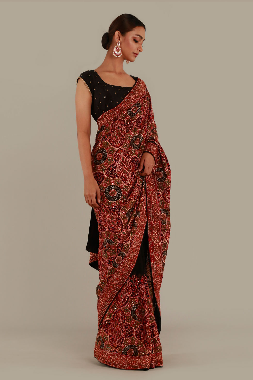Raven black saree with contrast multi coloured thread work and matching blouse with gold details