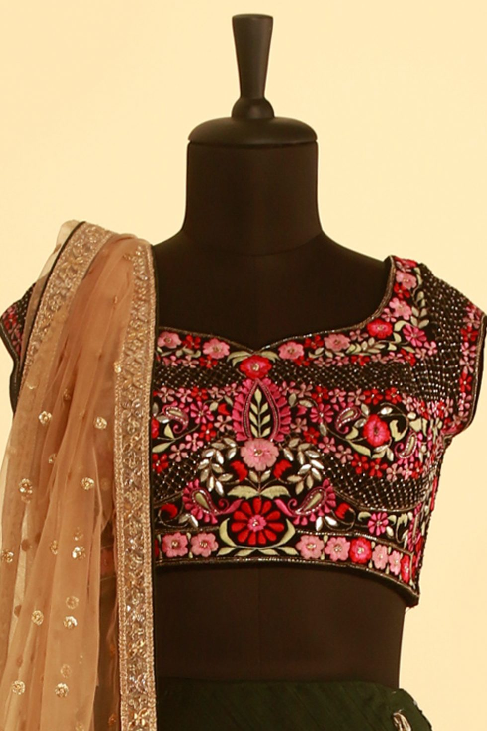 Forest green lehenga and contrast choli with multi colour floral embroidery and gold dupatta