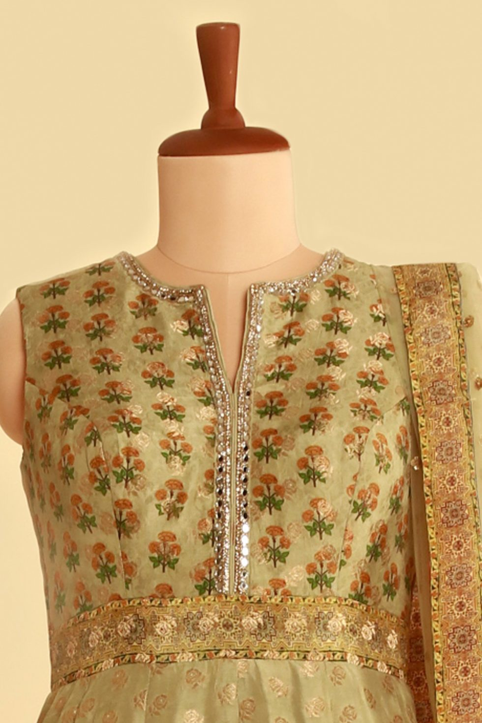Green printed banarasi anarkali gown set with gold and silver details and matching dupatta
