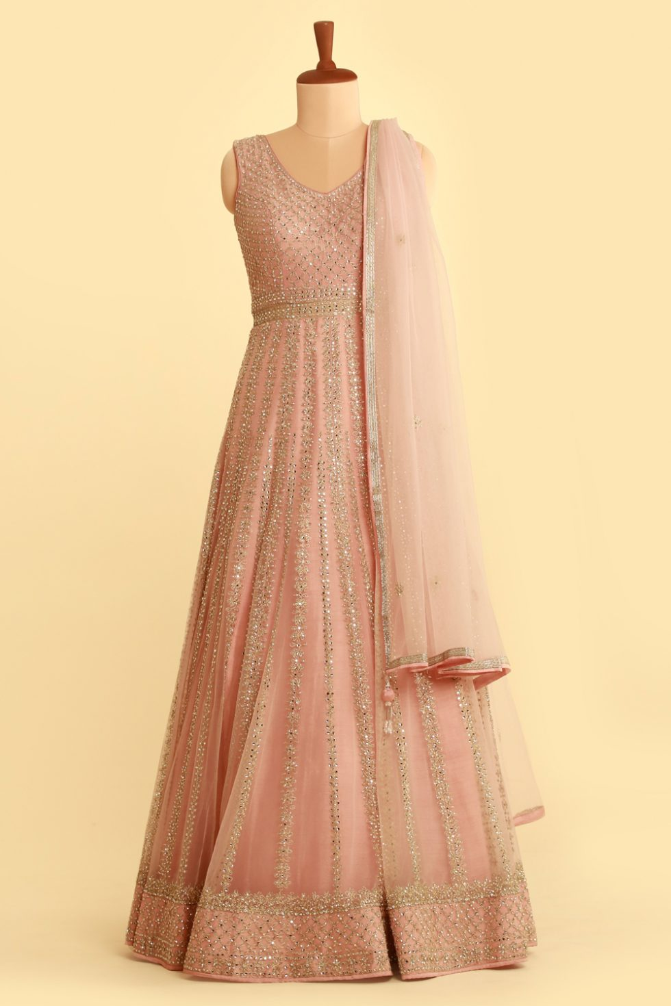 Baby pink anarkali gown set with matching dupatta and intricate silver details
