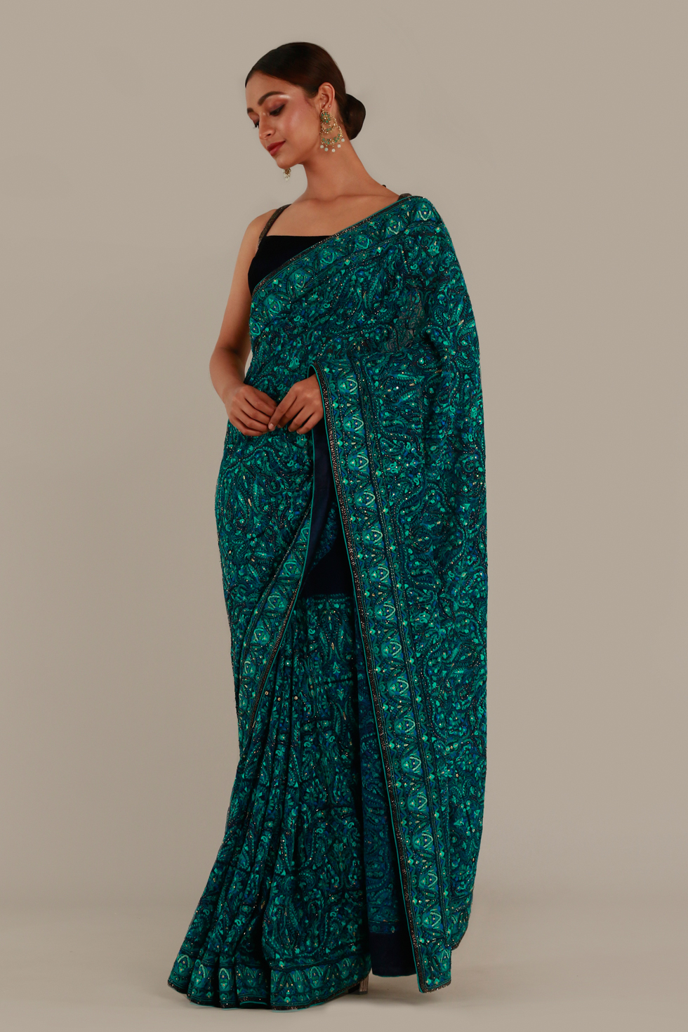 Emerald green classic saree with coloured thread work and black choli with embroidered straps