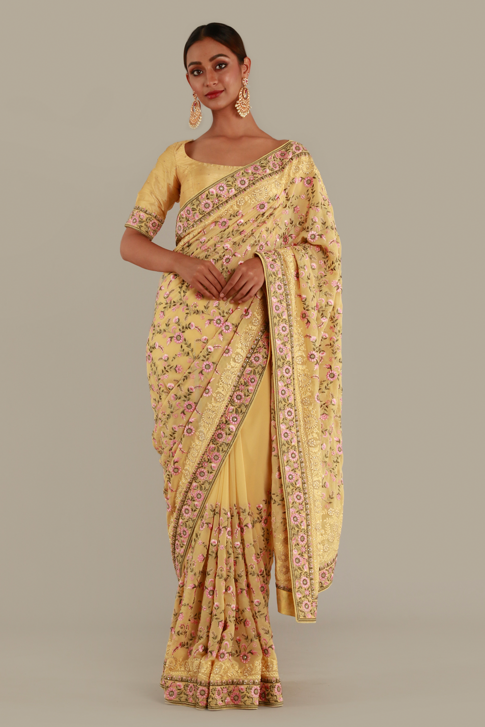 Summer yellow classic saree with contrast multi coloured thread work and matching blouse with butis