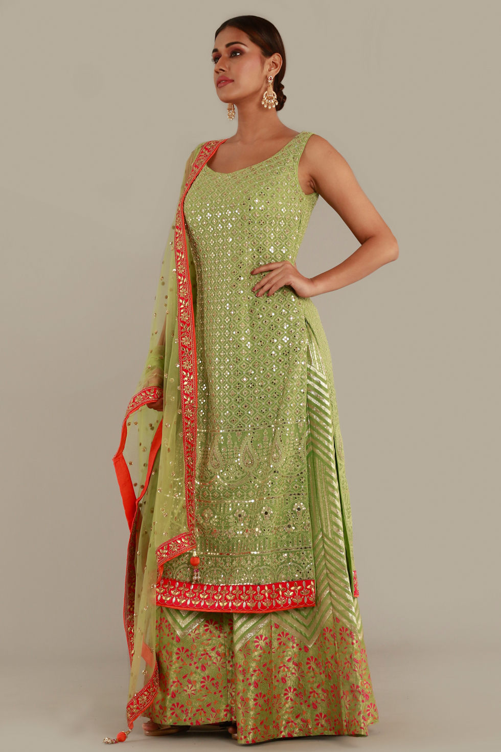 Dark lime green long kurti with Banarasi palazzo pants and gold details and matching dupatta with contrast borders and gold butis