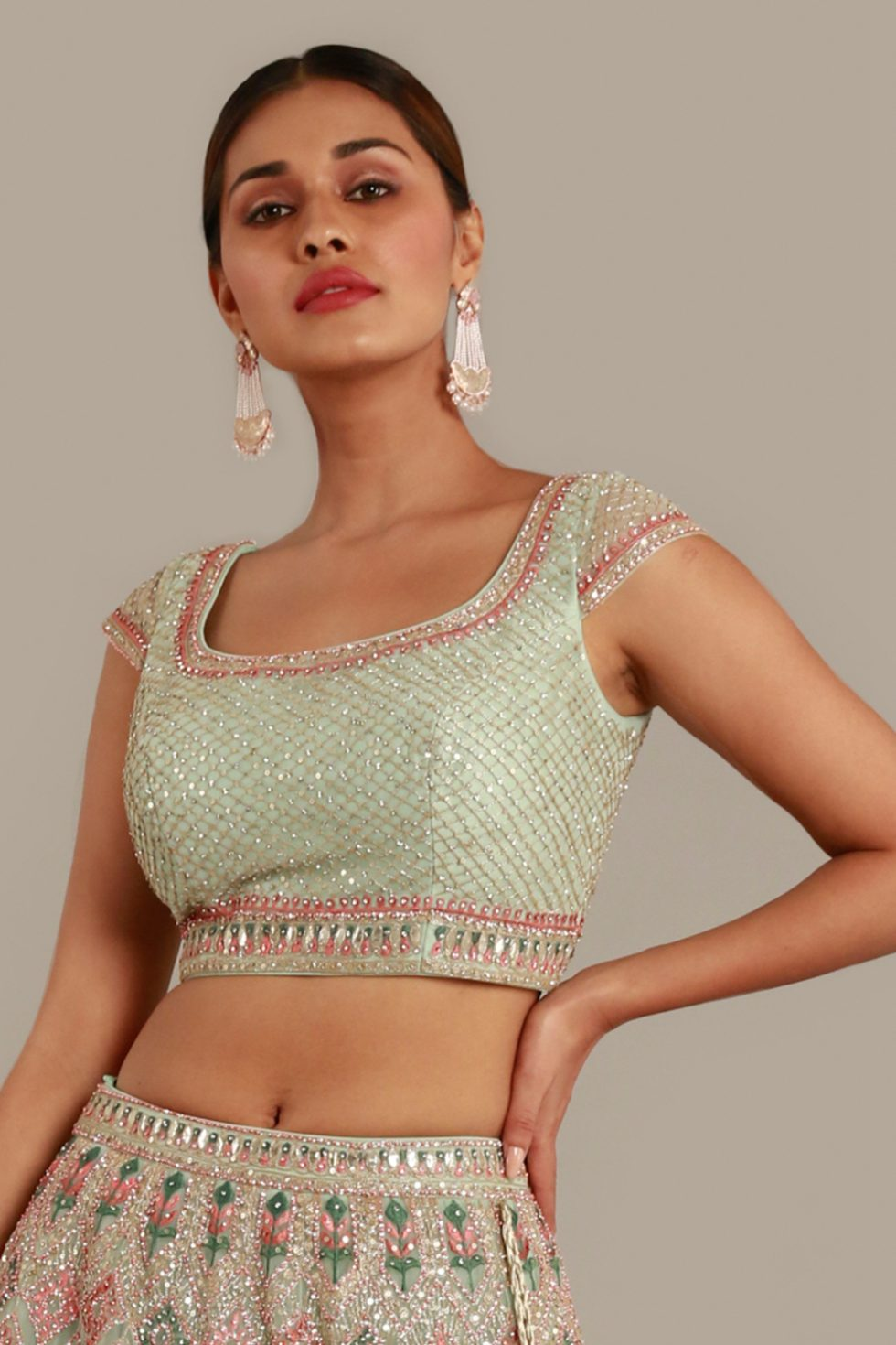 Powder green blouse with multi coloured embroidery, gota work and silver embellishments