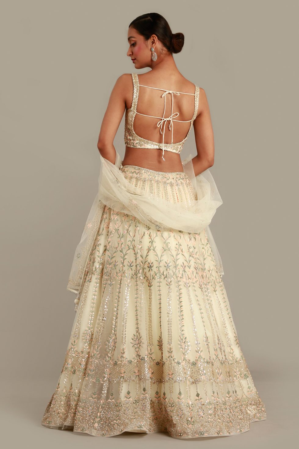 Cream ivory lehenga set with katori cut blouse, contrast embroidery, matching dupatta and silver highlights