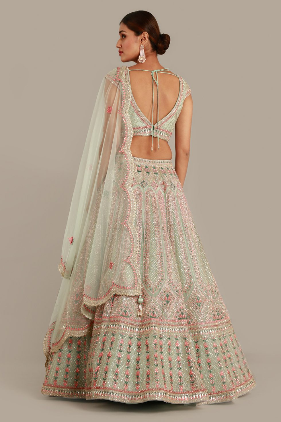 Powder green lehenga set with contrast multi coloured embroidery, gota work, matching dupatta and silver embellishments