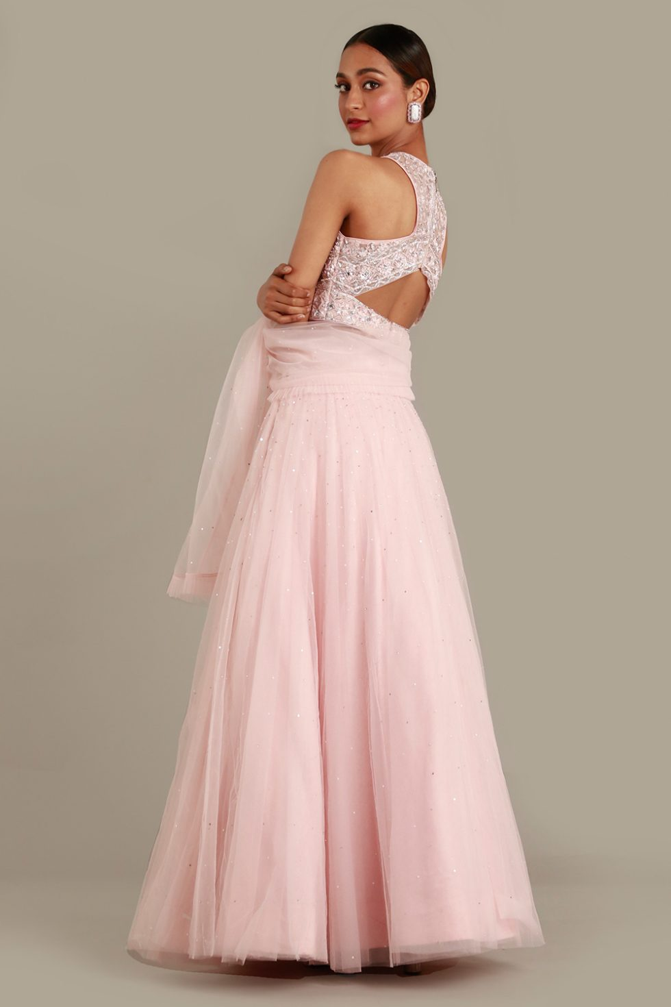 Petal pink tulle lehenga set with matching frill dupatta and embroidered blouse