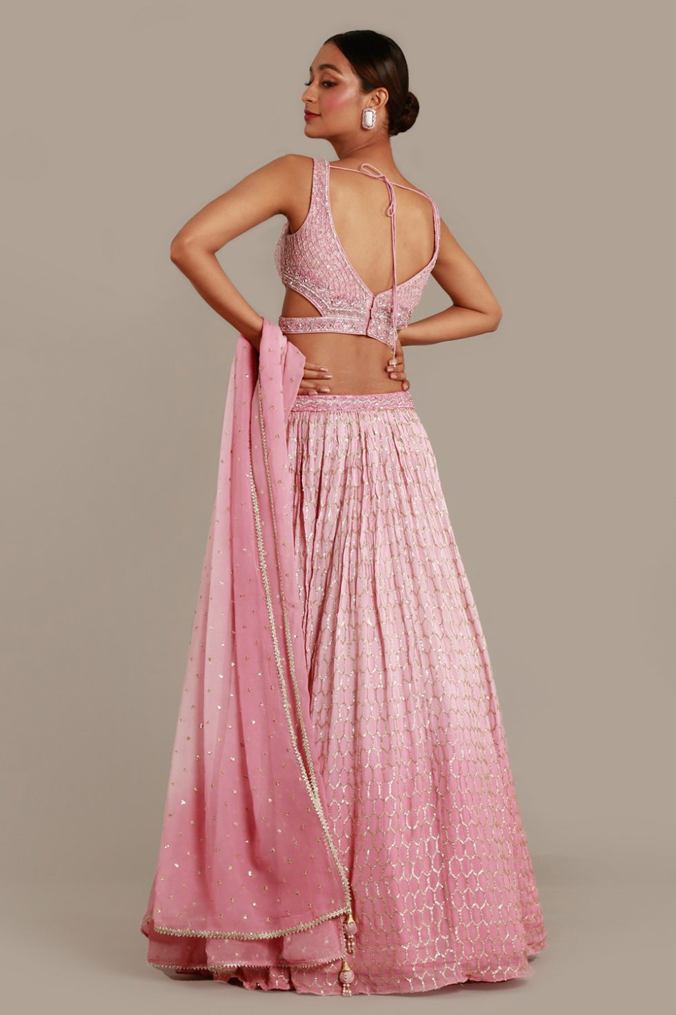 Rustic pink ombré lehenga set with cut out embroidered blouse and matching dupatta with butis