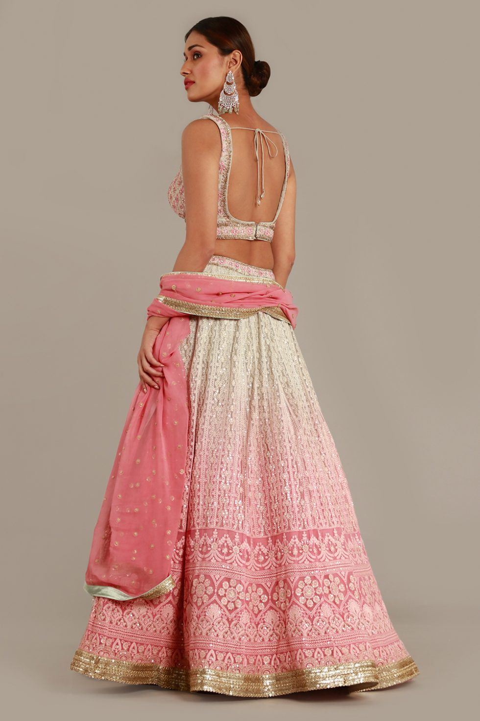 Steel grey to pink ombré lehenga set with thread work, gold highlights and matching pink dupatta with gold butis
