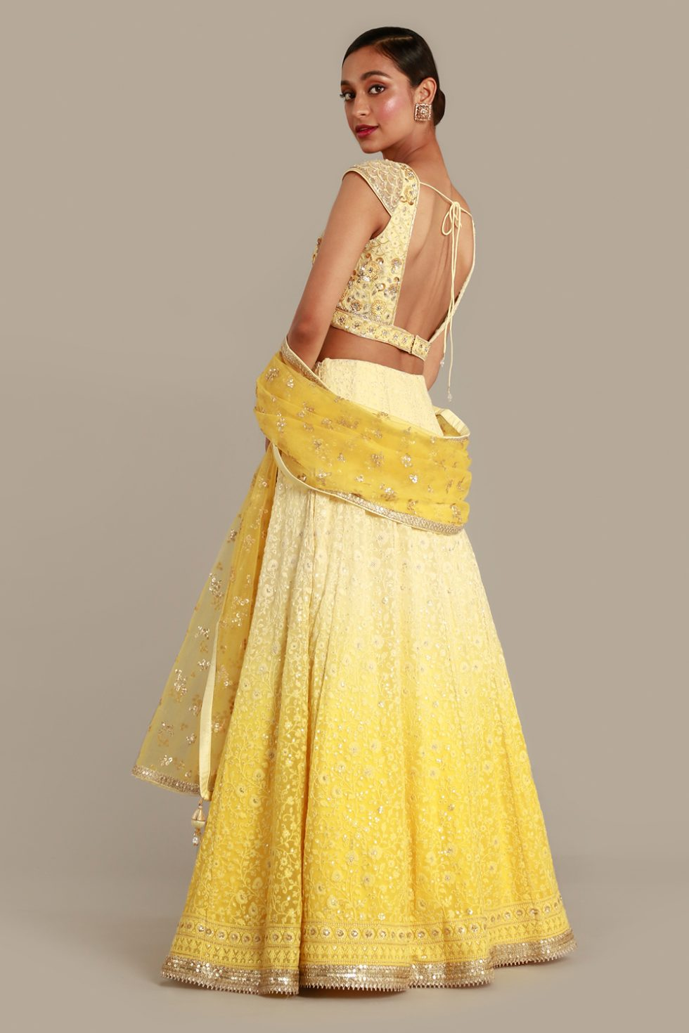 Sunshine yellow ombré lehenga set with thread work, matching choli and dupatta with self, silver and gold details