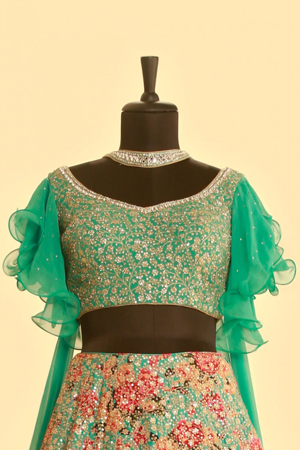 Sea green sequin lehenga set with floral motifs, frill sleeves and a matching necklace dupatta