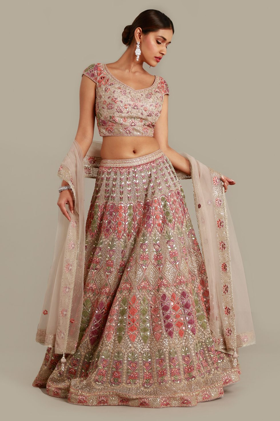 Stone grey lehenga set with contrast multi coloured embroidery, gota work, matching dupatta and silver embellishments