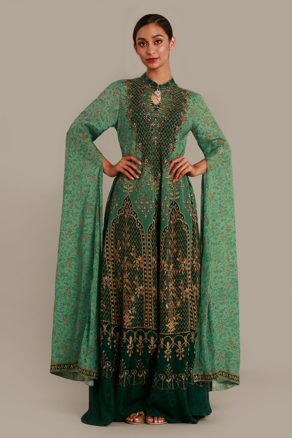 Fern green printed kurti with slit kaftan sleeves and gold embellishments.