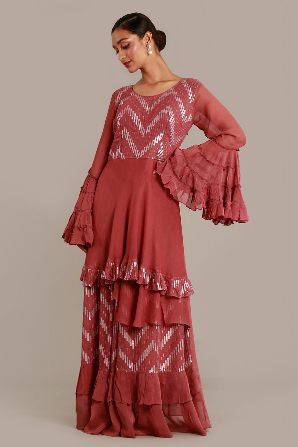 Dark pink long kurti with layered hem and sleeves and silver details