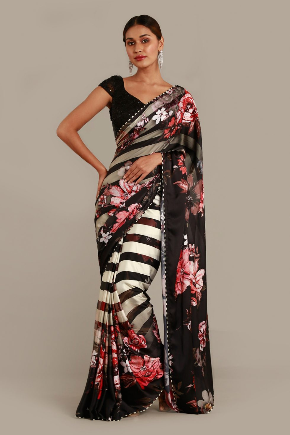Raven black classic saree with white stripes, contrast floral motifs and matching thread work and sequin detailed black blouse