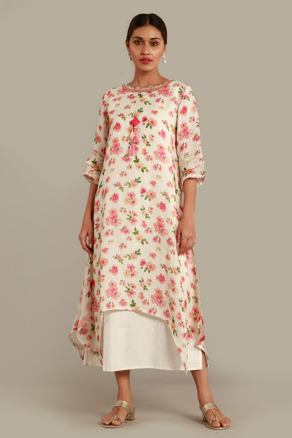 Ivory white layered kurti with contrast coloured floral print and tiered sleeves