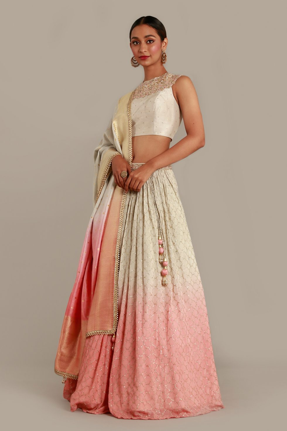 Off white ivory to pink ombré lehenga set with ombré Banarasi dupatta and matching cut out blouse with gold embellishments