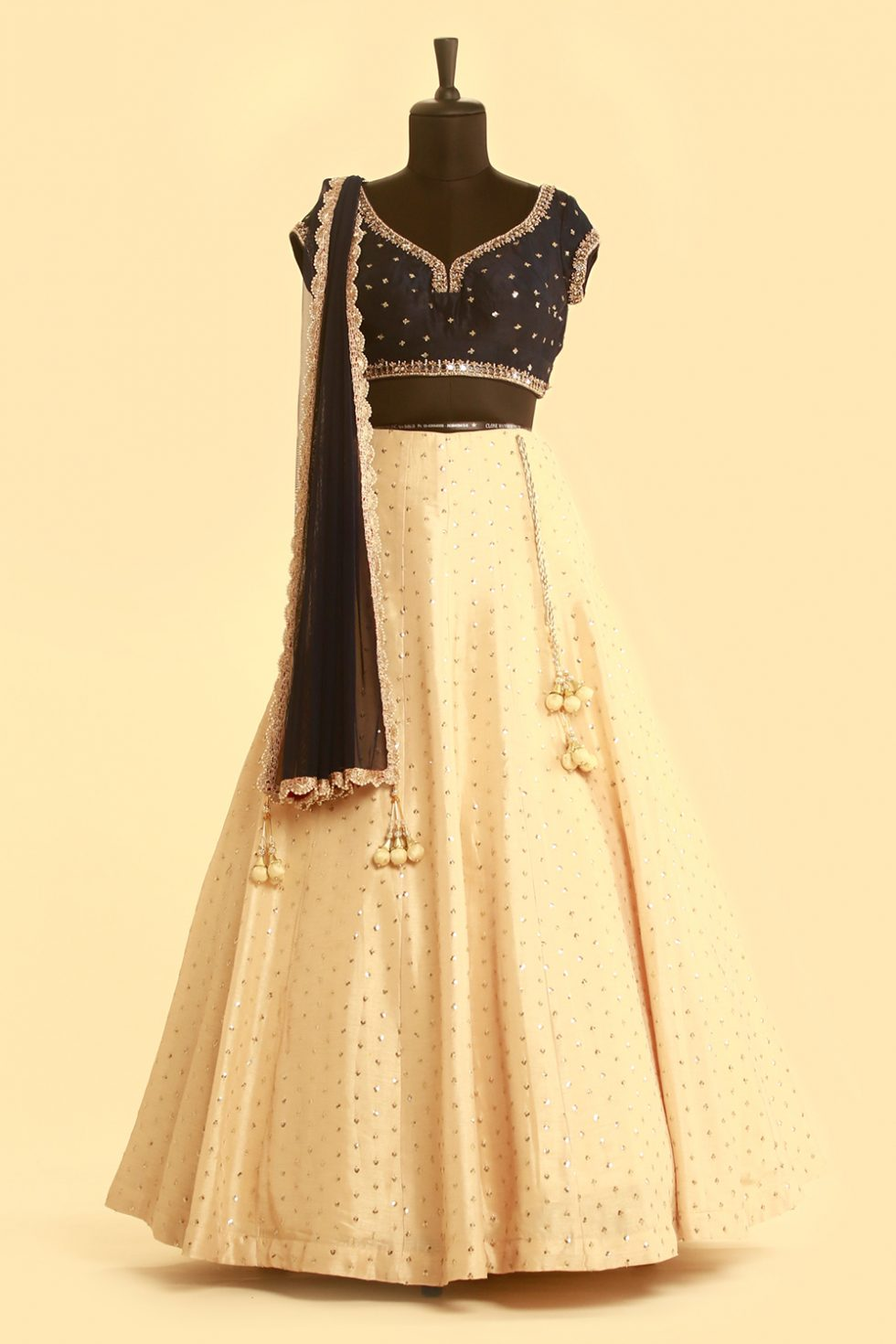 Contrast deep blue and beige lehenga set with mirror highlights and gold embellishments