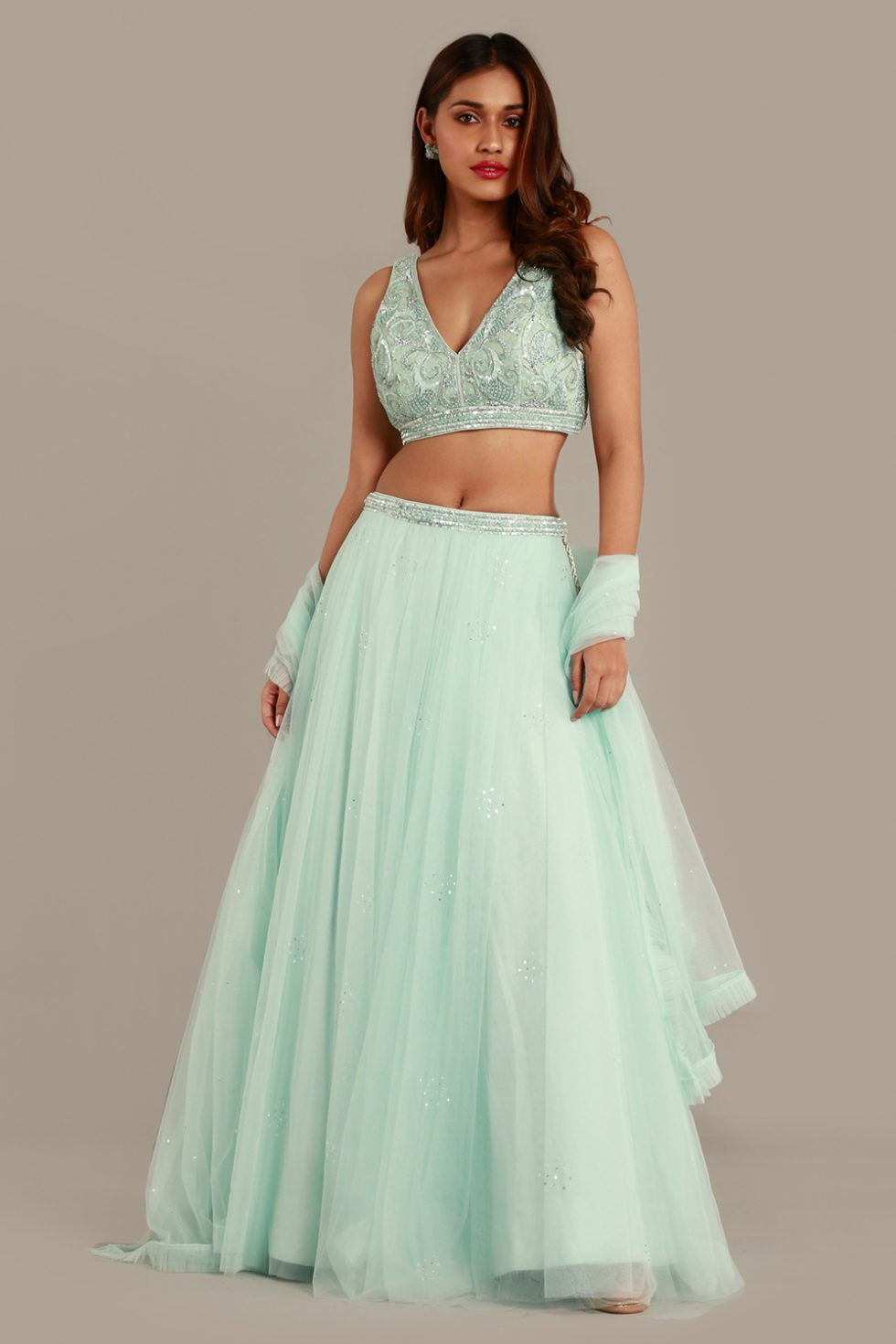 Baby blue tulle lehenga set with frill dupatta and matching embroidered choli with silver details