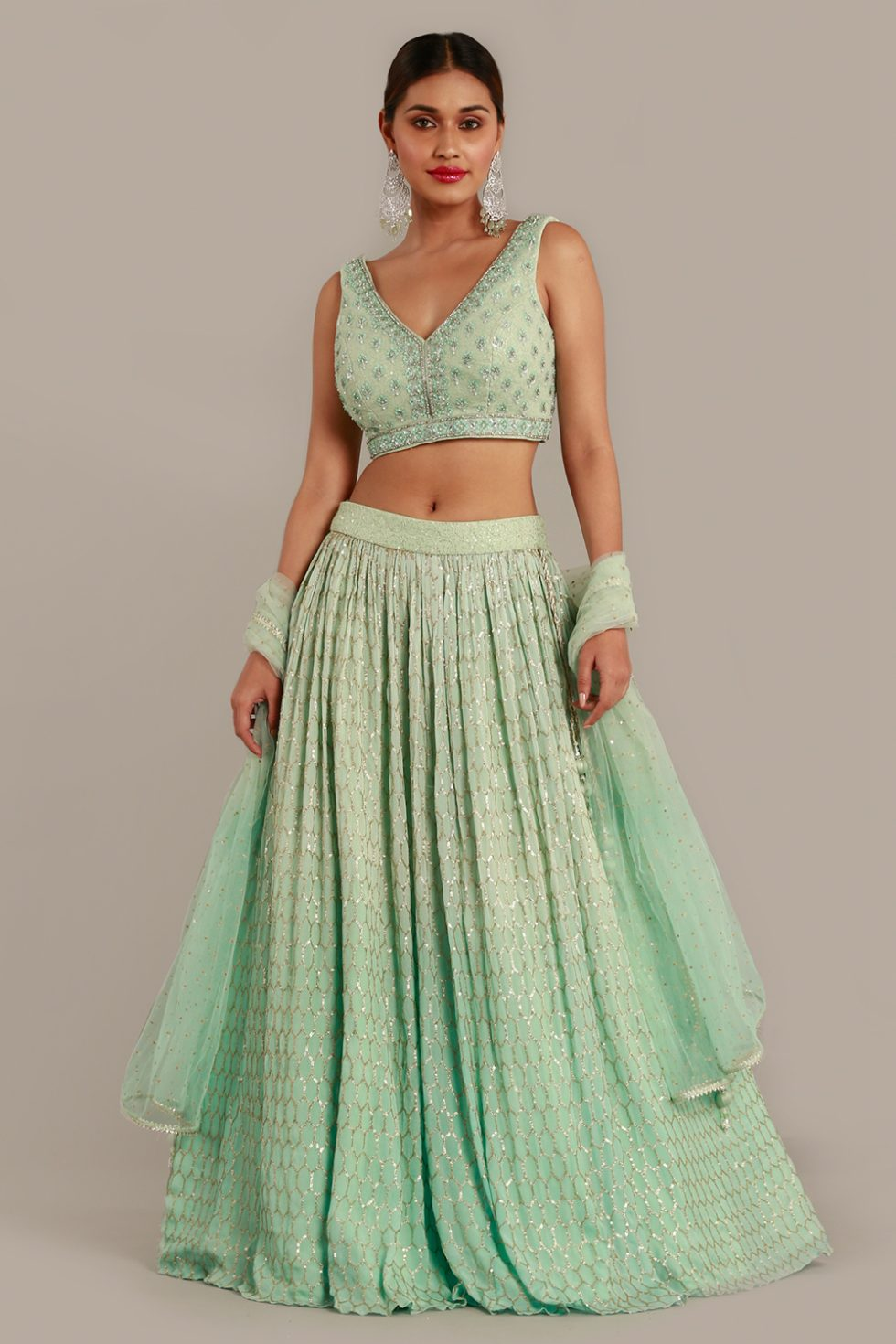 Mint green lehenga set with tie up back choli, self embroidered butis, matching dupatta and gold details