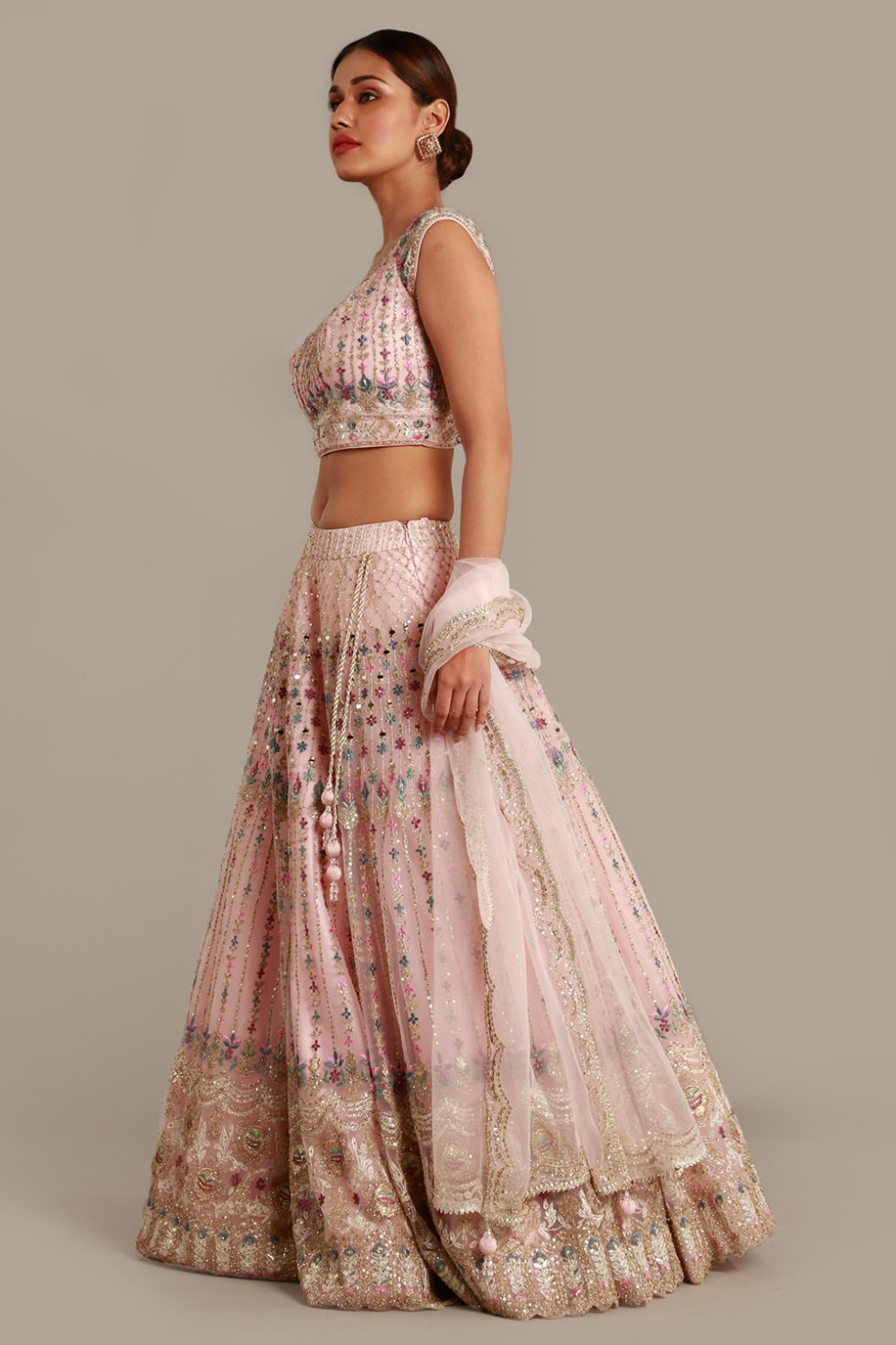 "Petal pink lehenga set with contrast multi coloured embroidery, ""abla"" work, matching dupatta and silver details"