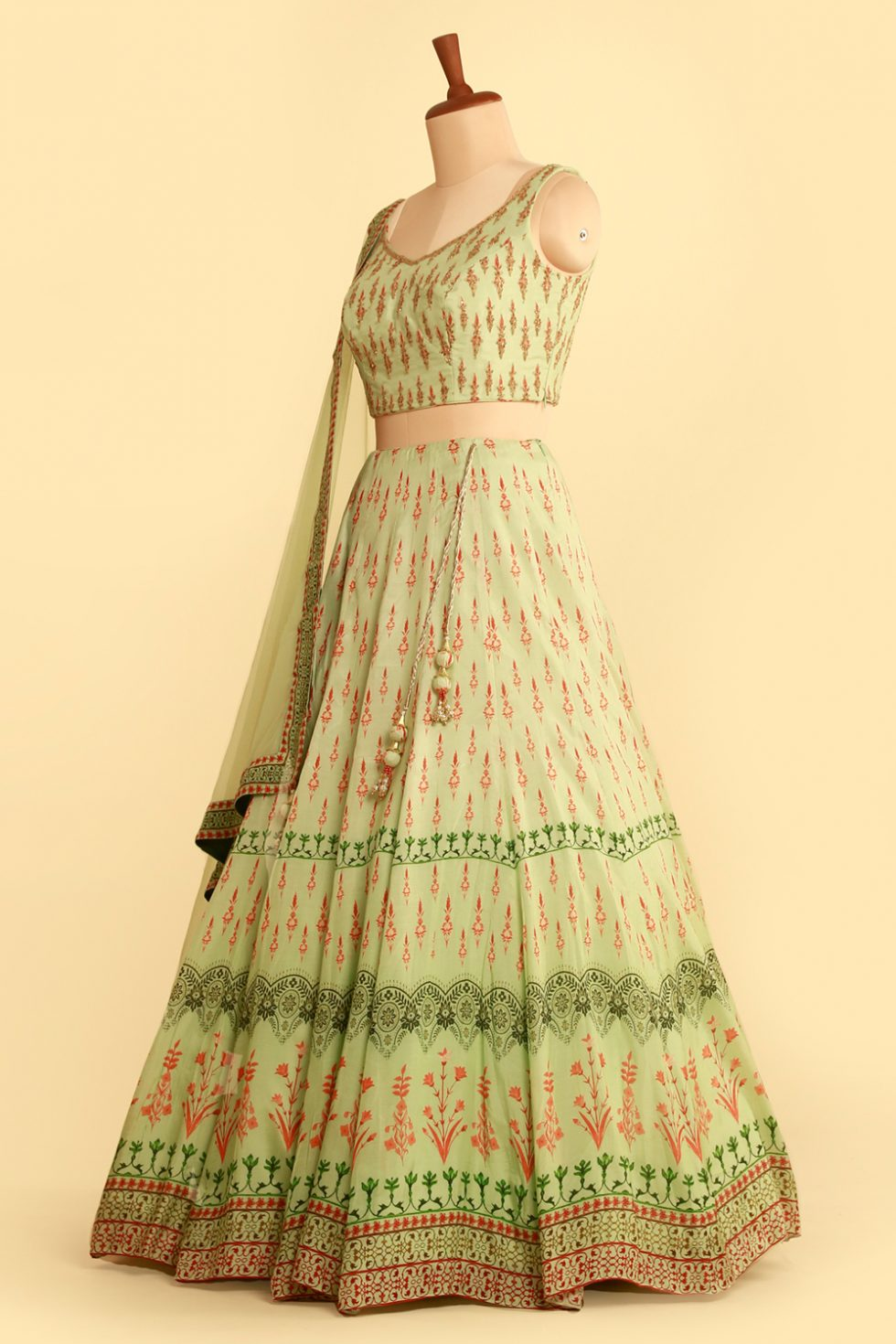 Pista green printed lehenga set with contrast dark pink colour and matching tulle dupatta