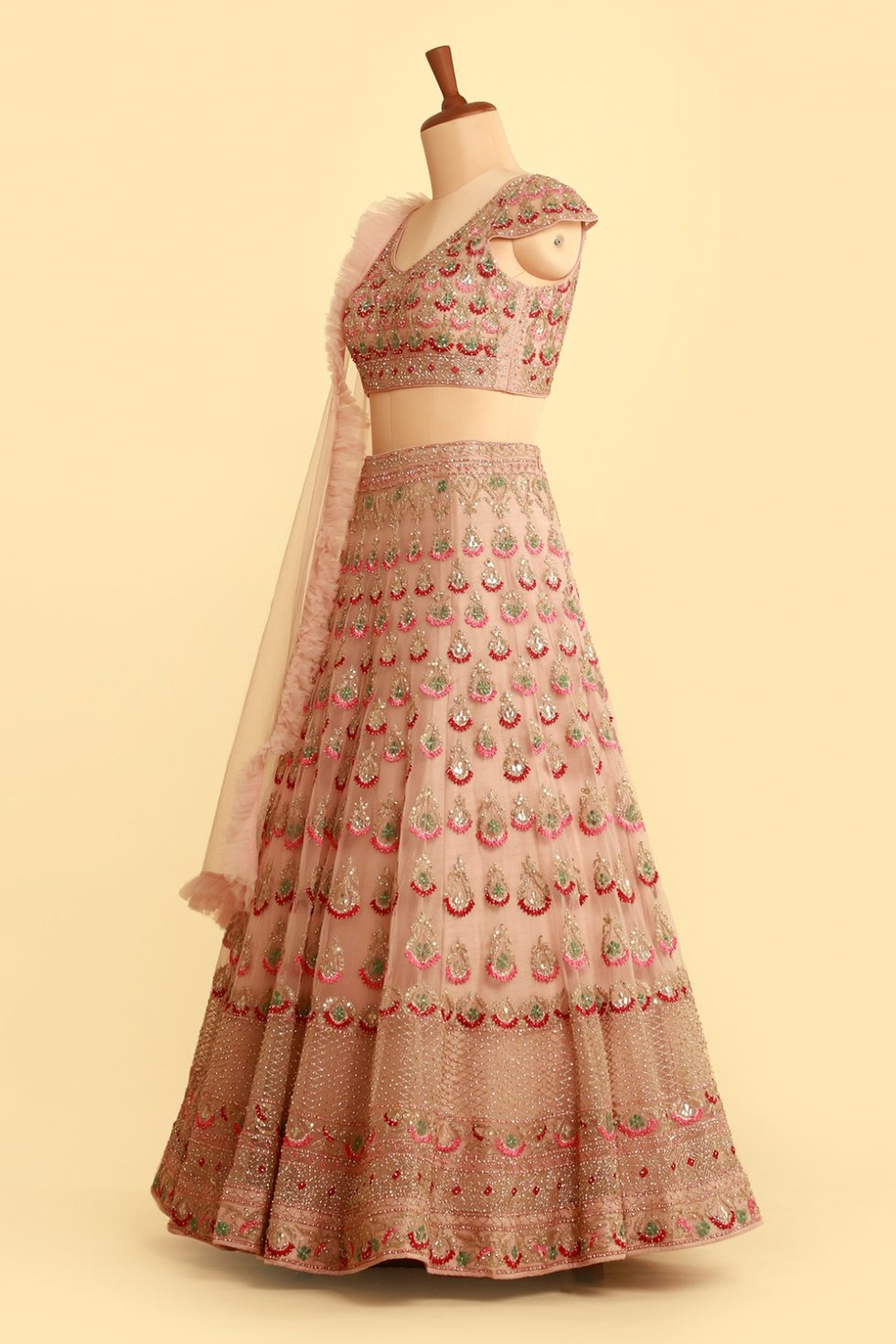 Blush pink lehenga set with contrast embroidery and frill dupatta with matching blouse