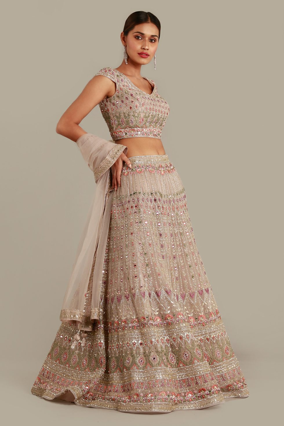 """Pastel grey lehenga set with contrast multi coloured embroidery, """"abla"""" and gota work, matching dupatta and silver embellishments"""