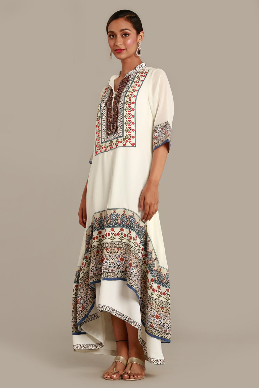 Powder white high low hem tunic kurti with multi coloured print and floral motifs