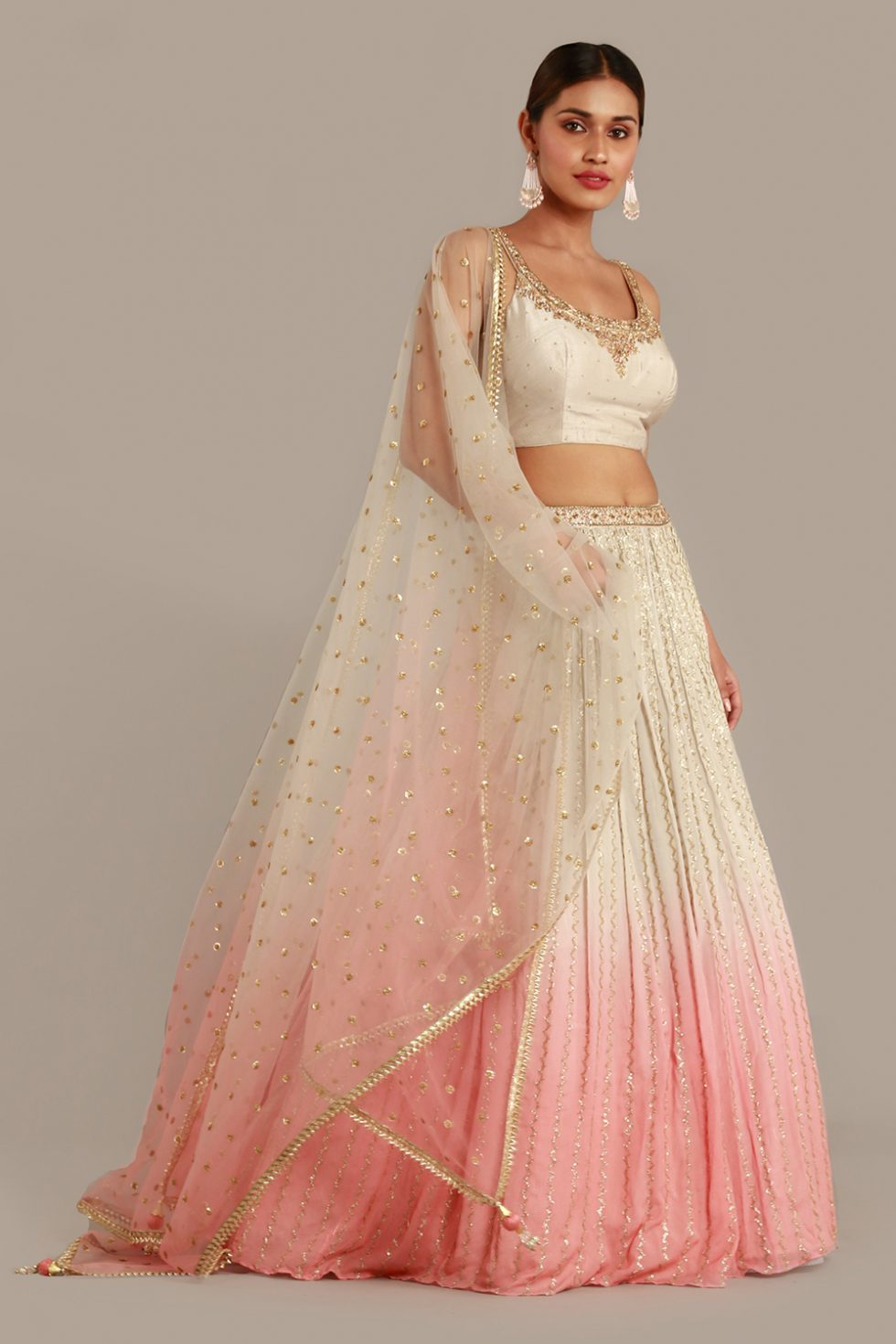 Pastel grey to pink ombré lehenga set with gold highlights, matching choli and ombré dupatta with gold butis