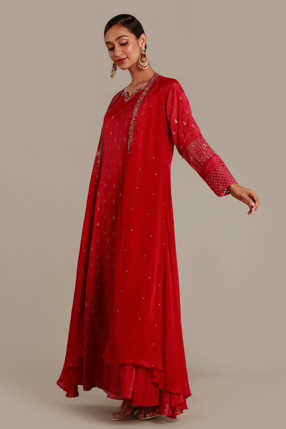 Magenta pink long kurti with thread work and butis and matching jacket with silver embellishments