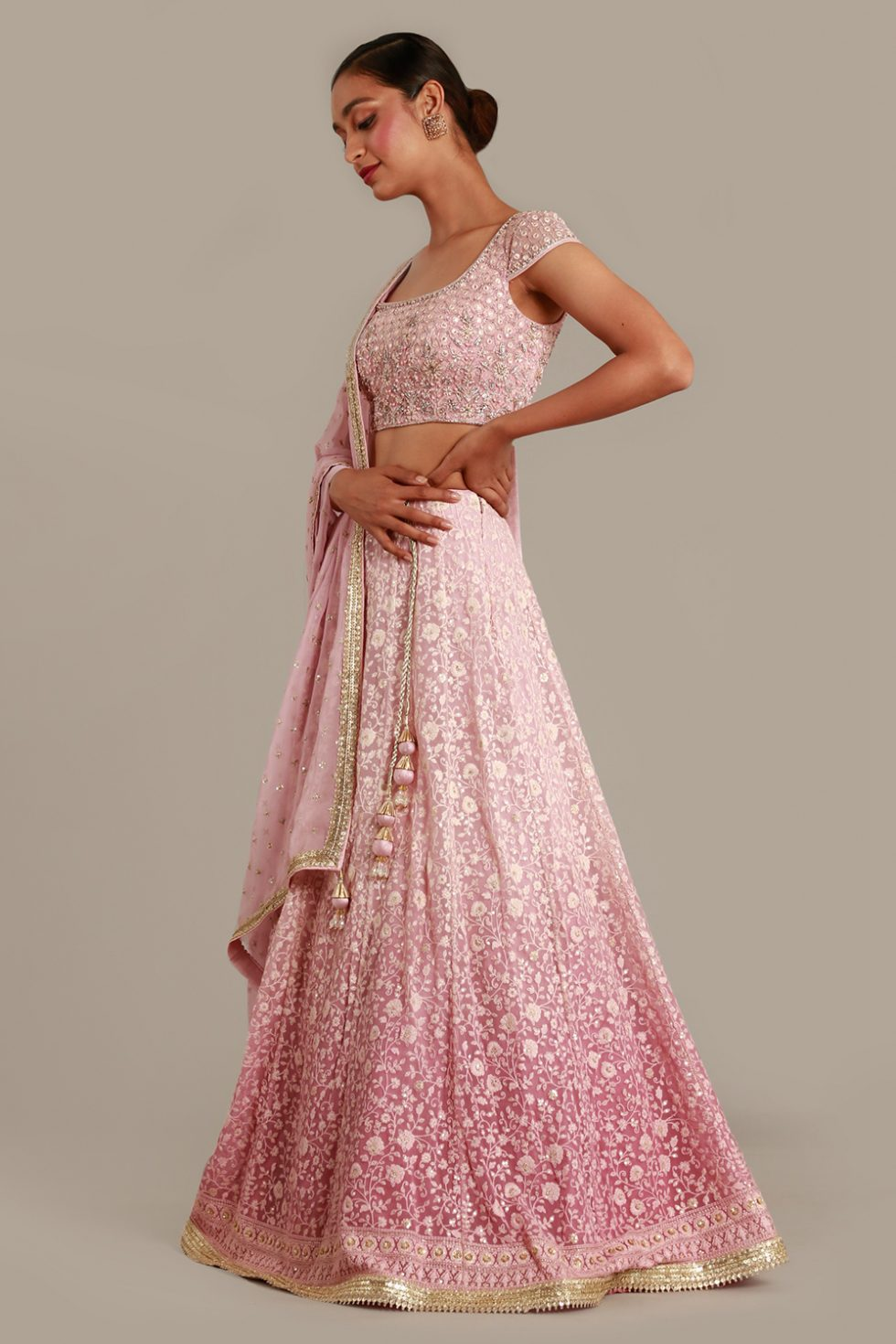 Pastel pink ombré lehenga set with thread work, matching dupatta and gold and silver embellishments
