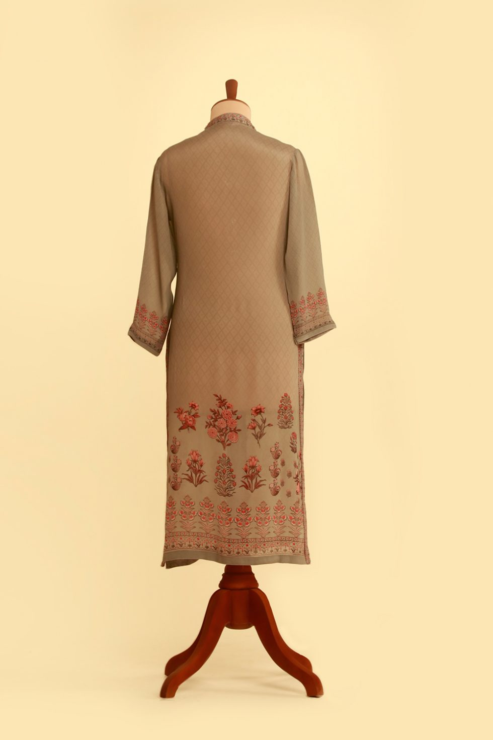 Grey printed kurti with multi coloured printed motifs and gold embellishments