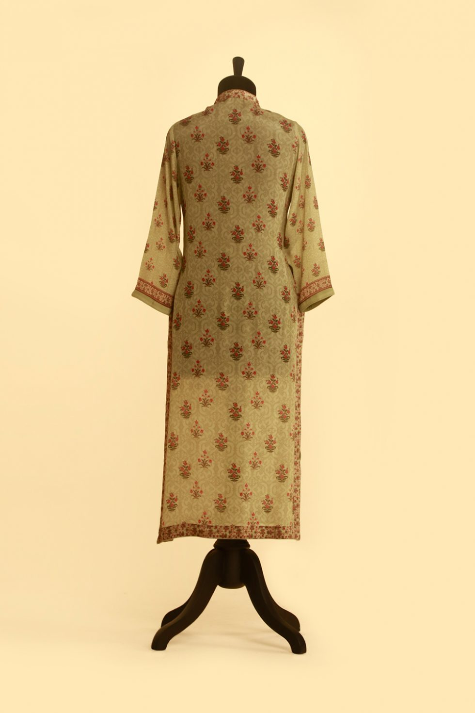 Lime green kurti with multi coloured buti print and gold highlights