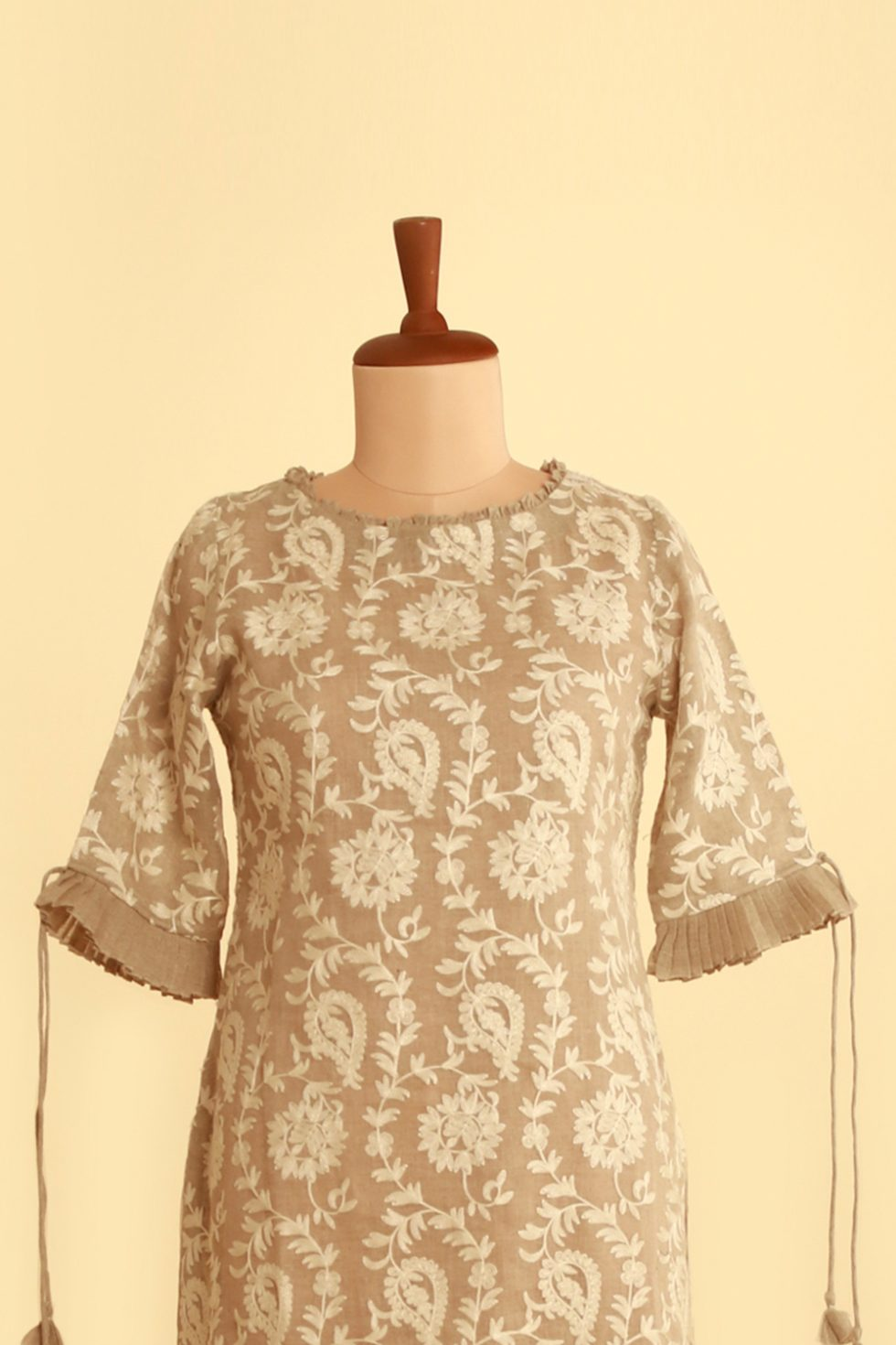 Steel grey kurti with ivory thread work and frill detail