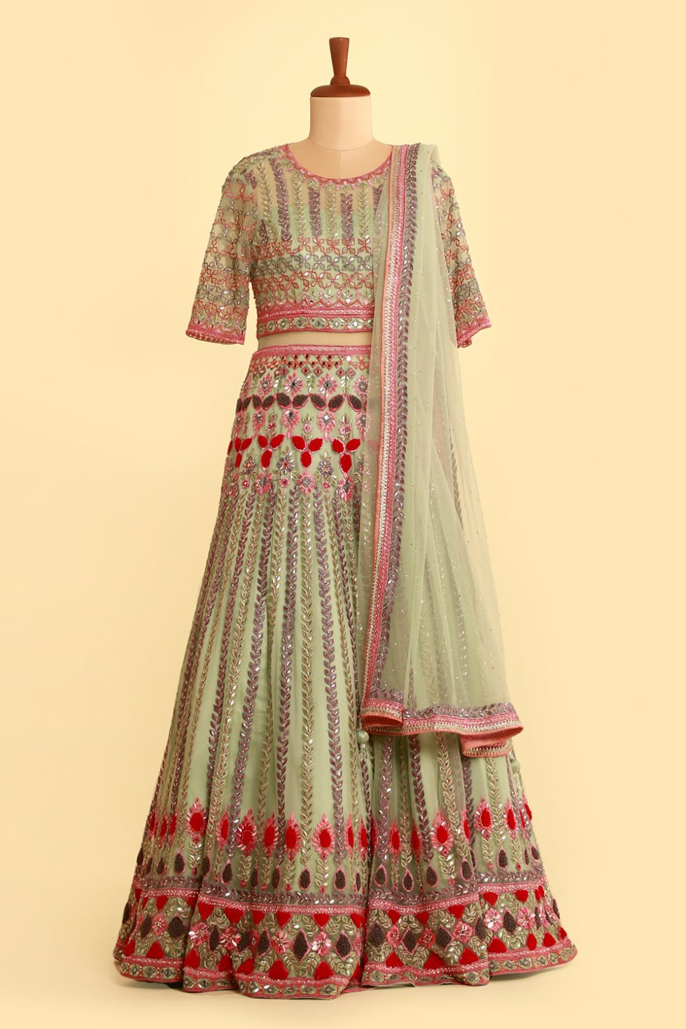 Baby green lehenga set with contrast embroidered and matching dupatta with bead work