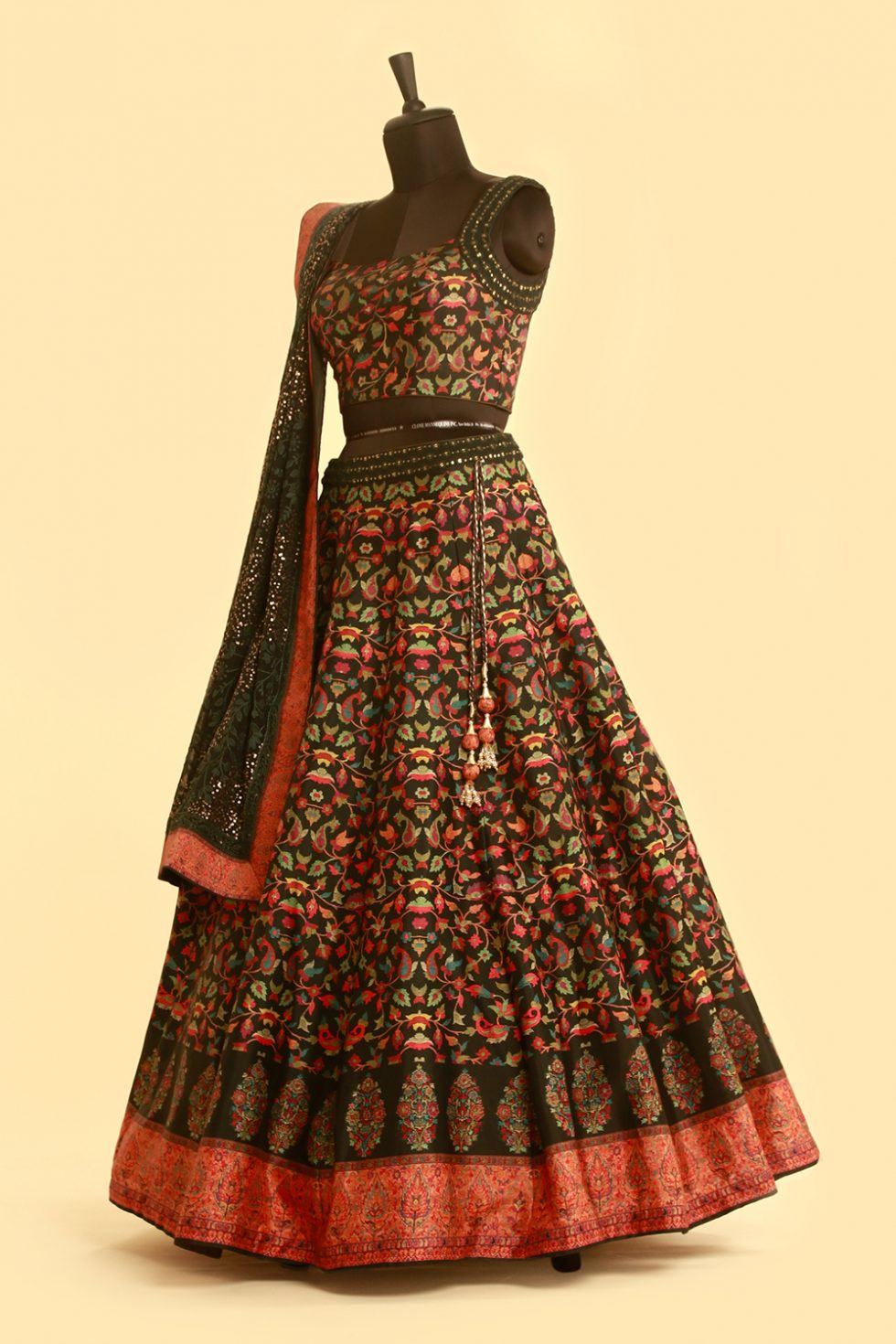 Dark green multicoloured printed lehenga set with sequin embellished dupatta and contrast border