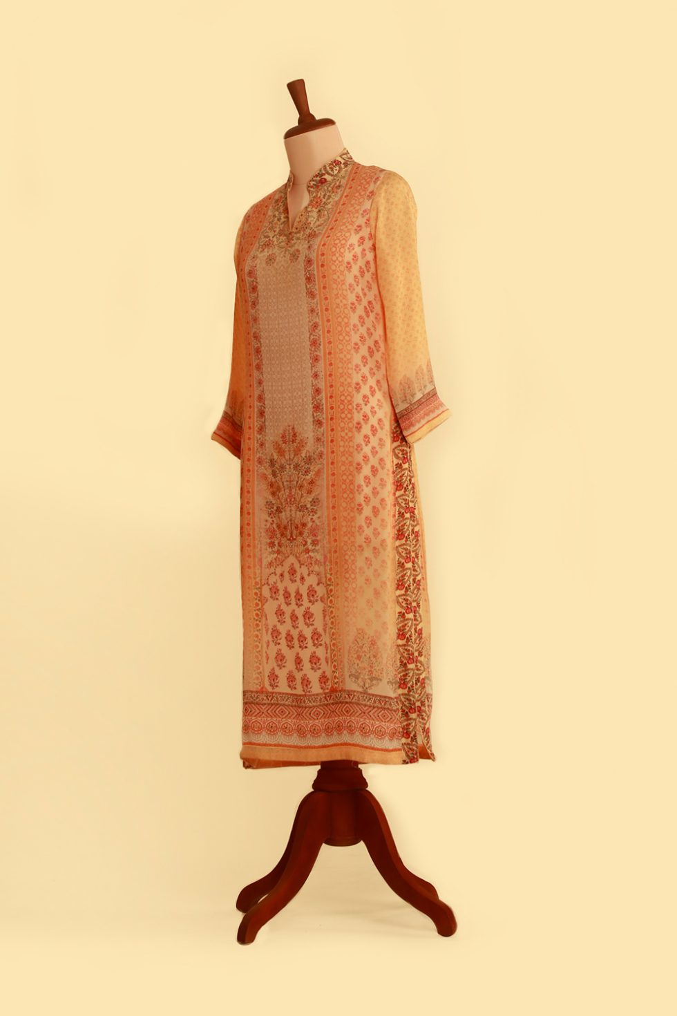 Orange printed kurti with floral motifs and gold highlights