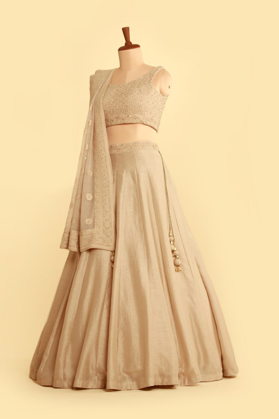 Light Grey lehenga set with matching blouse and thread embroidered dupatta with gold embellishments