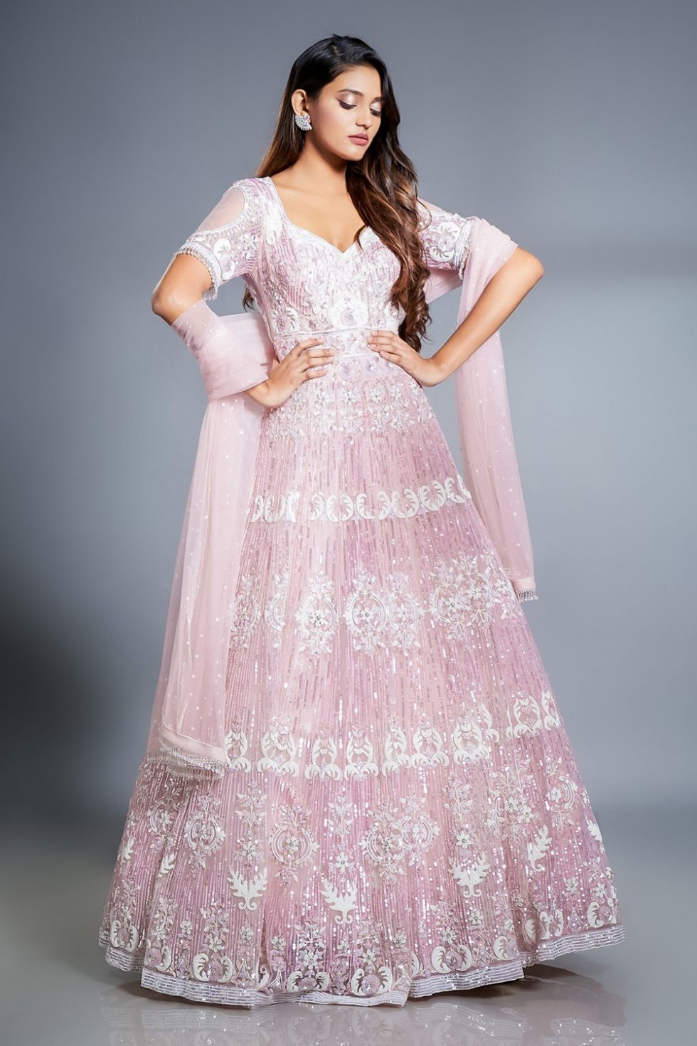 Rose pink gown set with self colour, ivory and silver 'paani' sequin and pearl hand embroidery with cut out sleeves and a matching dupatta with tassels.