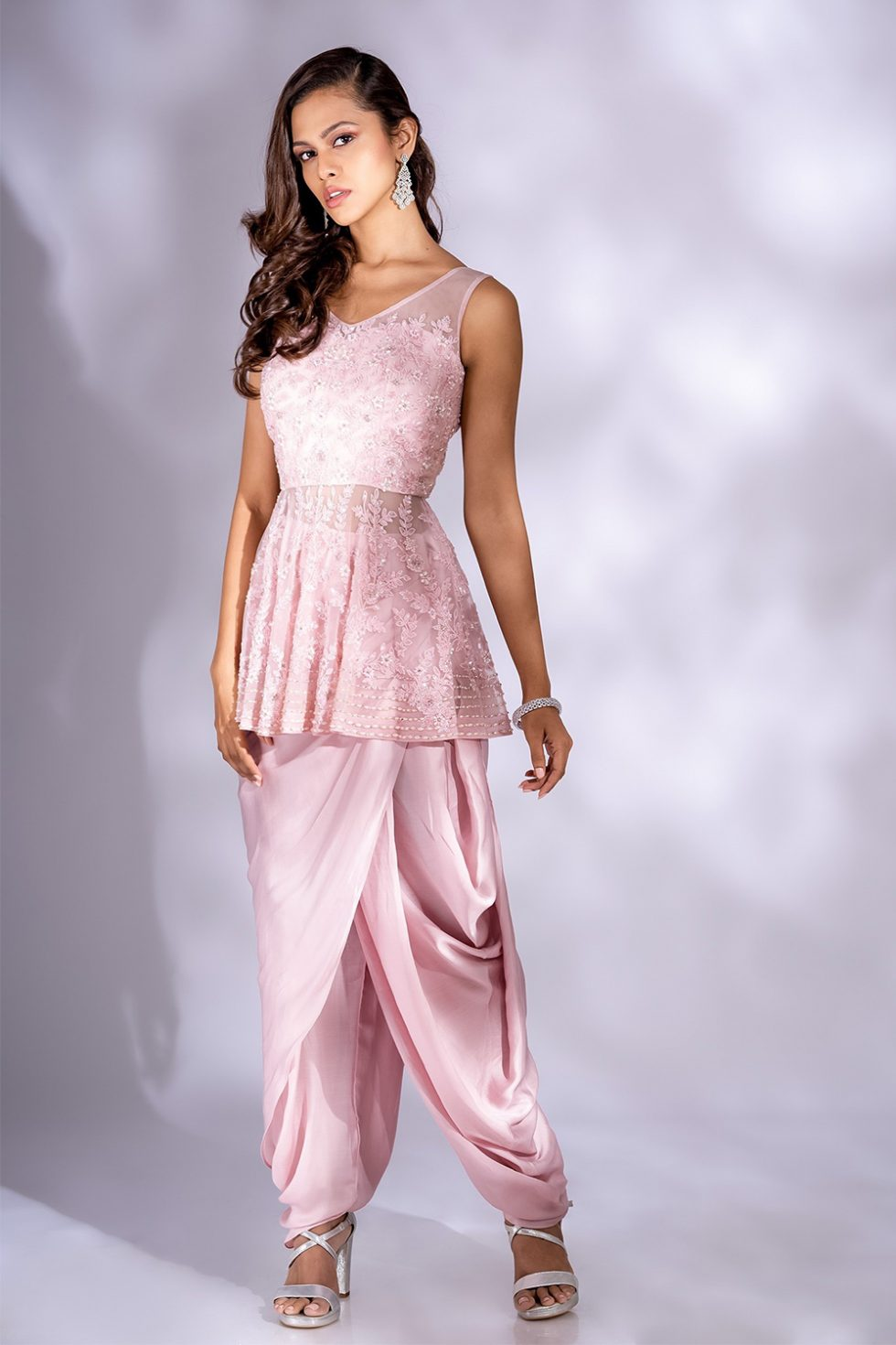 Petal pink draped dhoti set with a peplum style top with self coloured hand embroidery.