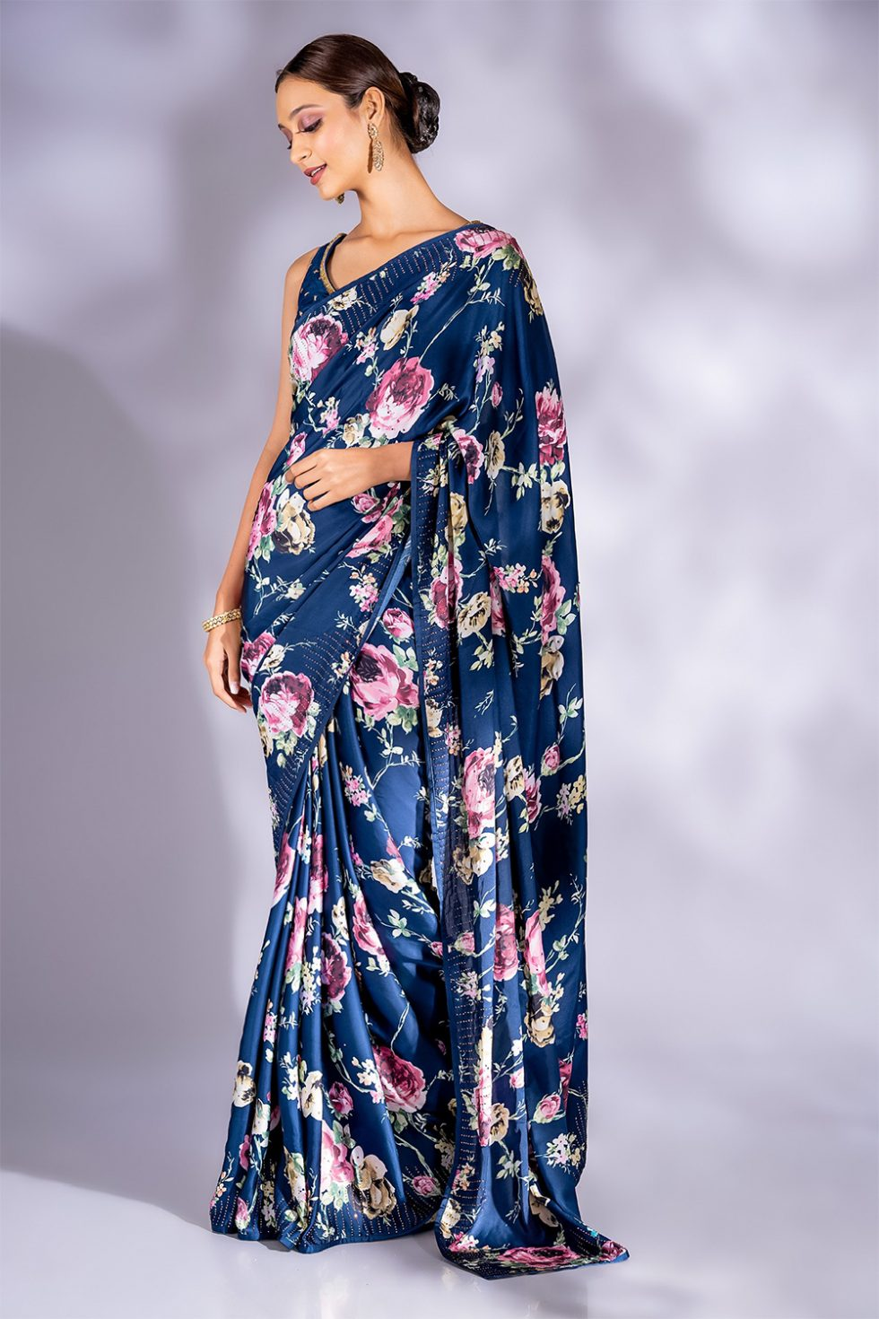Deep blue printed classic saree paired with a matching choli with butis and gold embellishments.