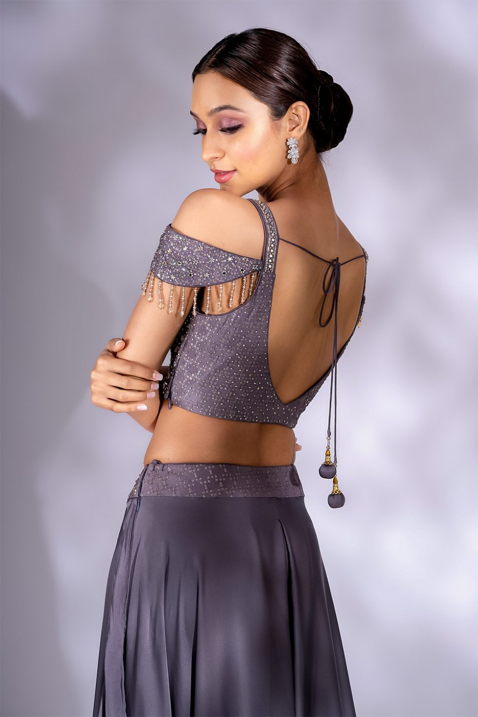 Dusty grey wide palazzo pant set with mirror work blouse, belt and cold shoulder with tassels paired with a matching stole dupatta.