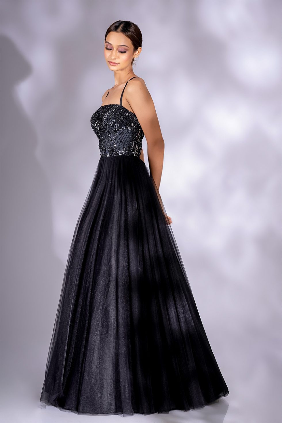 Charcoal black tulle gown set with hand embroidered bodice and silver embellishments.